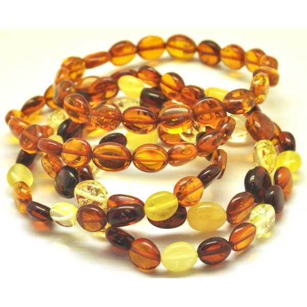 Amber bracelets | Lot of 5 button shape Baltic amber bracelets