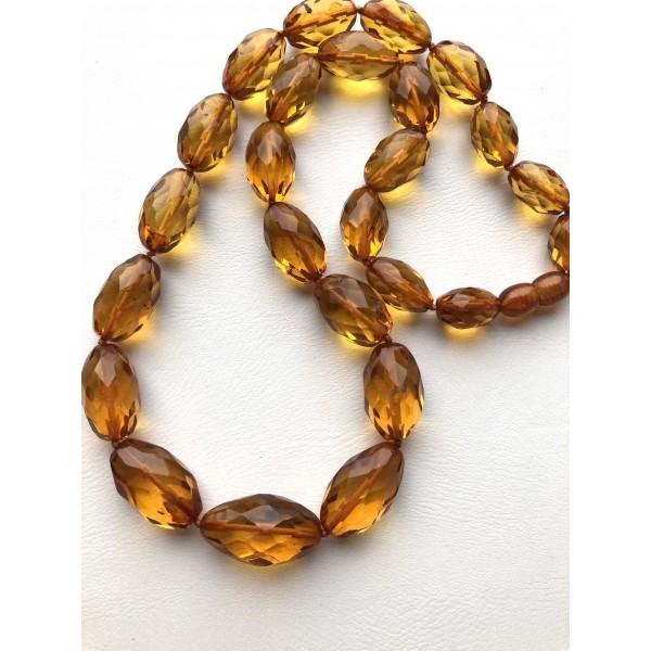 Faceted olive shape amber necklace -