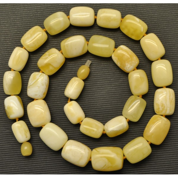 Amber necklaces | Barrel shape yellow - white Baltic amber necklace 40 g .