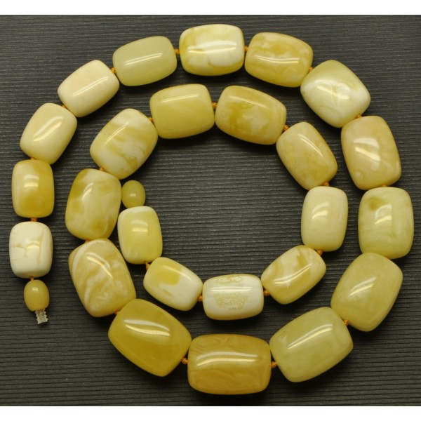 Amber necklaces | Barrel shape yellow - white Baltic amber necklace 56 g .