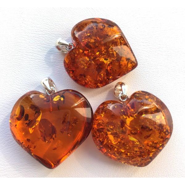 Amber pendants | Lot of 3 cognac amber heart pendants