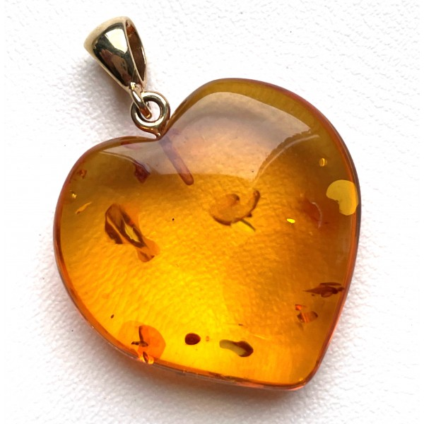 Heart shape Baltic amber pendant with 14 carat gold -
