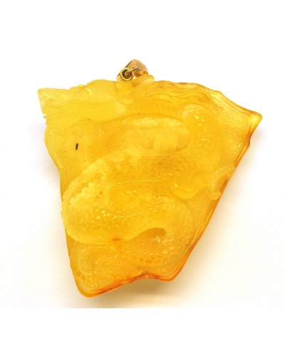 Large Baltic amber pendant with hand carved figure of dragon