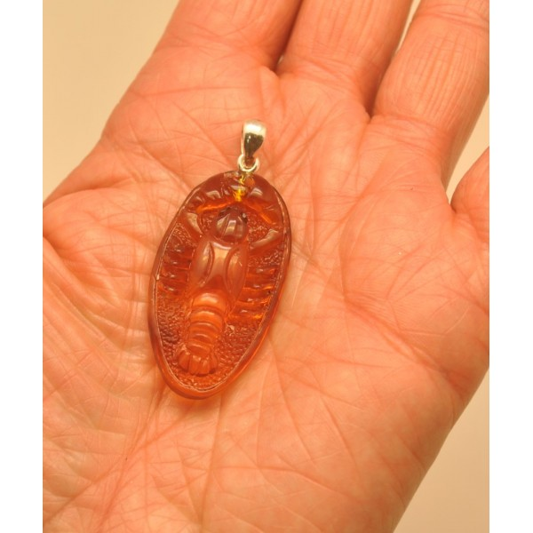 Amber pendants | Hand carved cognac color Baltic amber pendant of crawfish