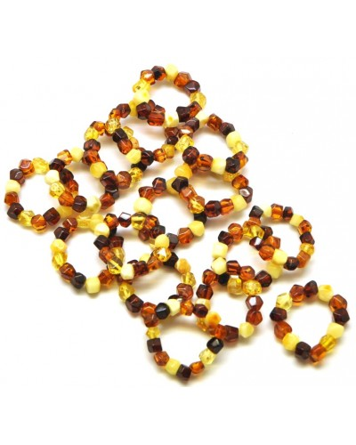 Lot of 16 faceted Baltic amber rings