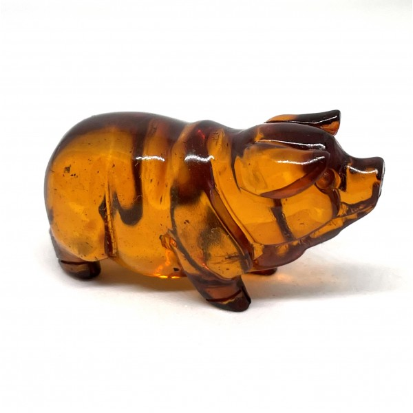 Hand carved amber figure of pig 10 g -