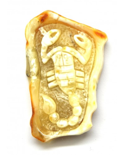 Baltic amber stone with hand carved figure of scorpio