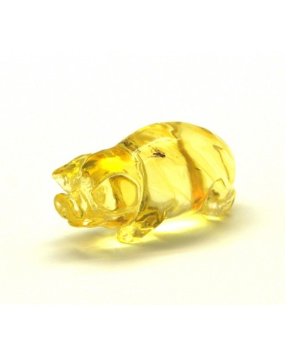 Hand carved transparent Baltic amber figure of pig with insect