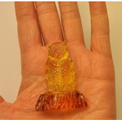 Hand carved transparent Baltic amber figure of owl