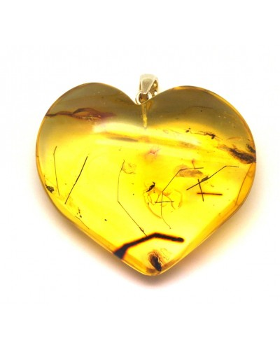 Big Baltic amber heart pendant with insects