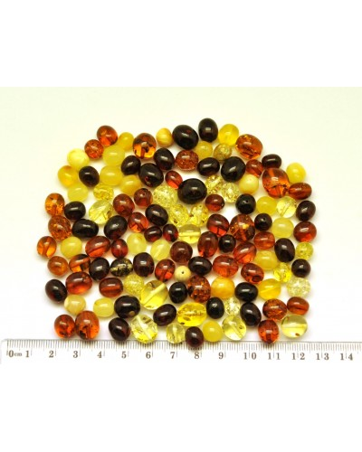 Loose drilled Baltic amber olive shape beads 50 g .