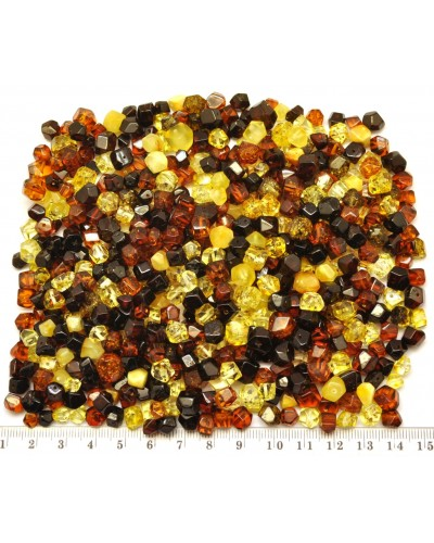 Drilled  amber faceted beads 100 g .
