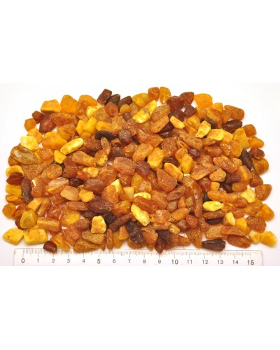 Raw drilled Baltic amber pieces 100 g .