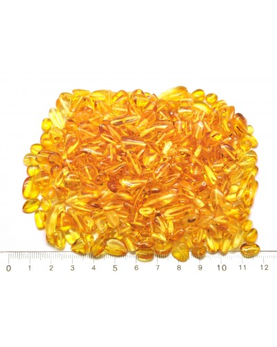 Drilled Baltic amber beans shape peaces 50 g.