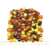 Loose drilled button shape amber   beads 50 g .