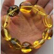 Big beads amber bracelet with insects